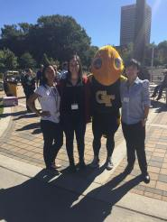 Co-presidents Ollie Macgorman and Jennifer Franklin and Instrumentationist Alice Zhao poses with GT mascot Buzz in Altanta, GA